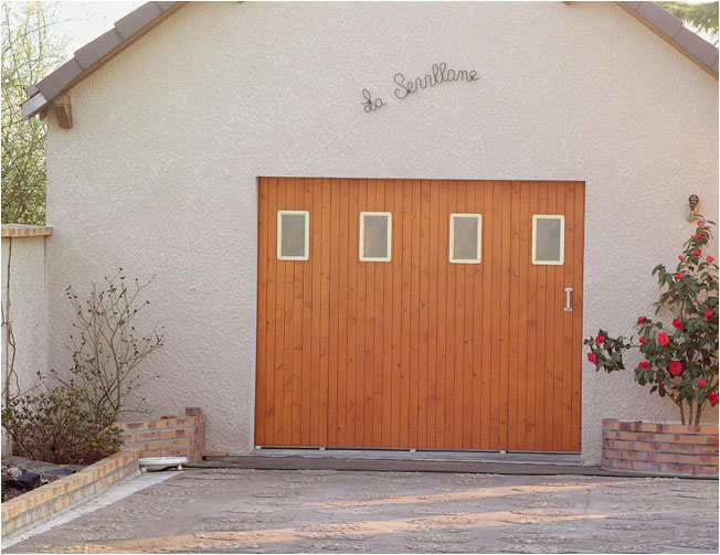 Pose de portes de garage janibel for Poseur de porte de garage